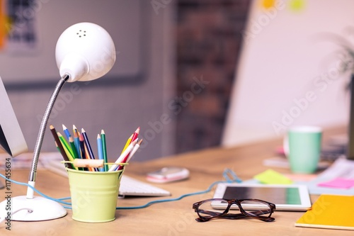 Obraz na plátne  Digital tablet, spectacles and penholder on a table