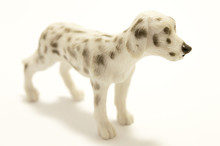 Toy Dog Made Of Plastic On A White Background.