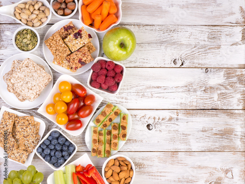 healthy-snacks-on-wooden-table-top-view