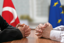 Negotiation Of Turkey And European Union. Statesman Or Politicians With Clasped Hands.