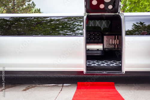 White limousine with inviting open door Poster