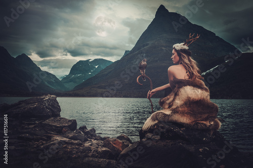 Nordic goddess in ritual garment with hawk near wild mountain lake in Innerdalen valley Canvas-taulu