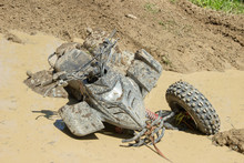 Large Dirty ATV Stuck In A Pud...