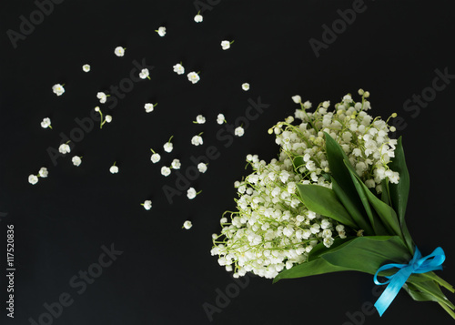 Bouquet of lily of the valley, tied with turquoise ribbon. Top view.