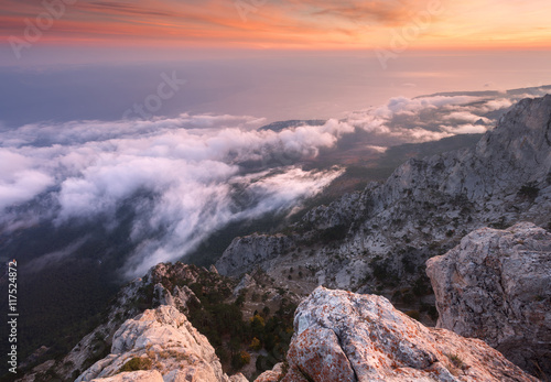 Beautiful landscape on the mountain with low clouds at sunset