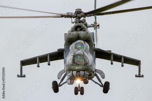 obraz dibond Front view of a flying attack helicopter
