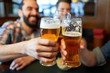 canvas print picture - happy male friends drinking beer at bar or pub