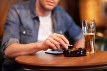Man Drinking Beer And Smoking ...
