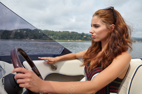 Spoed Foto op Canvas Water Motor sporten Summer vacation - young woman driving a motor boat
