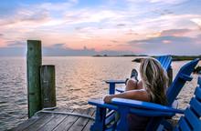 Female Enjoying A Sunset On A Chesapeake Bay Pier