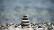 pebble tower against blue sea