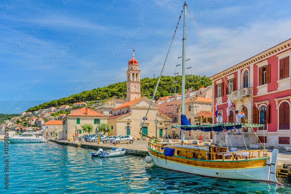 Fototapety, obrazy: Pucisca town coastline cityscape. / Pucisca is small mediterranean town on Island of Brac, touristic destination in Croatia, Europe.