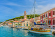 canvas print picture - Pucisca town coastline cityscape. / Pucisca is small mediterranean town on Island of Brac, touristic destination in Croatia, Europe.
