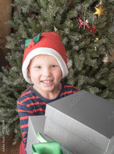 Fotografie, Obraz  Boy having lots of christmas presents smiling