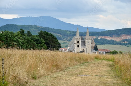 Poster Monument St. Martin's Cathedral with rural landscape in the background in Spisska Kapitula, Slovakia.