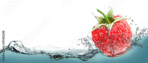 Raspberries in a spray of water. Canvas Print