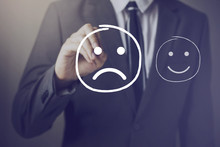 Customer Choosing To Write Unhappy Face Over Happy Face