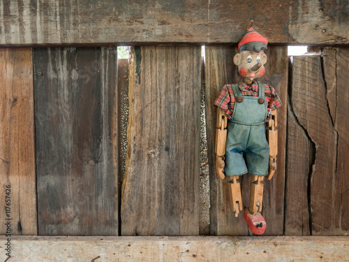 Old Pinocchio wooden marionette hang on wall - Buy this