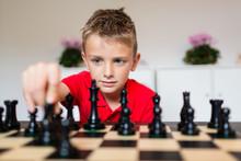 Boy Playing Chess