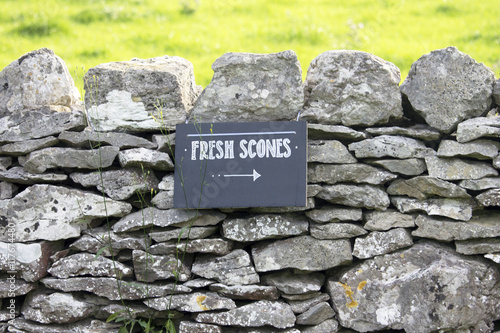 Fresh Scones Sign on Stone Wall