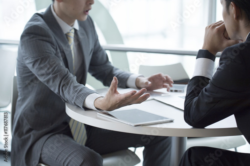 Two young businessmen have a meeting