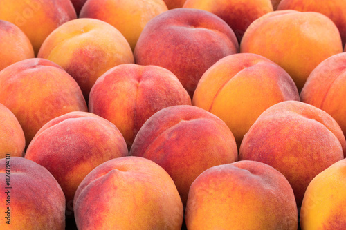 Ripe peach fruit background, close up.
