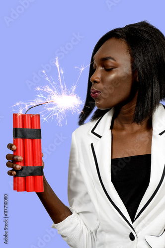 Fotografie, Obraz  Young woman holding dynamite