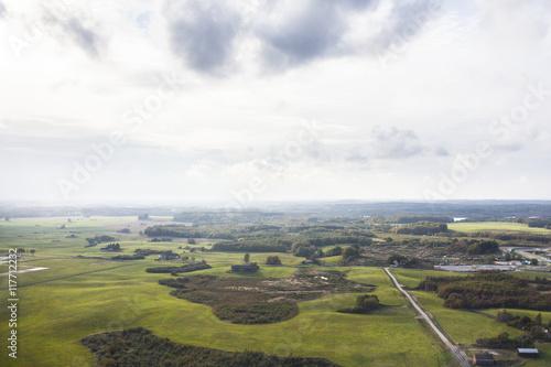 Papiers peints Sauvage Aerial view of green landscape against sky