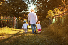 Kids Walk With Grandfather In ...