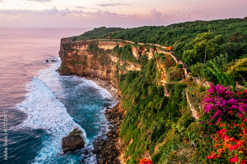 Scenic landscape of high cliff with fantastic sunset sky at Uluwatu . Travel Bali, Indonesia