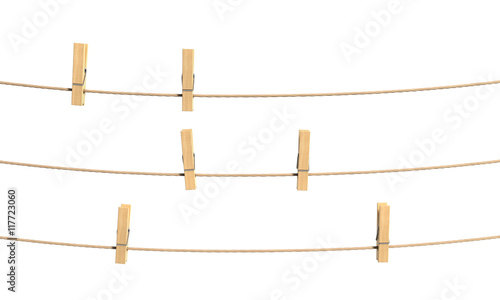 Photo  Set of clothespin on the rope. 3d illustration