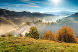 Fototapeta Góry - Colorful autumn landscape with misty valley,Holbav,Transylvania,Romania,Europe