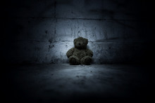 Teddy Bear Sitting In Haunted House,Scary Background For Book Cover