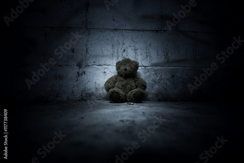 Fotografie, Obraz  Teddy bear sitting in haunted house,Scary background for book cover