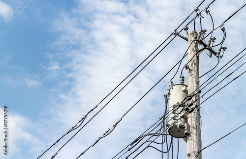Fotografie, Obraz  Wooden electricity power pole with wires and transformer, copyspace