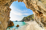 Fototapeta Kamienie - Beach and sea water in Corfu island, Pelion, Mylopotamos, in summertime in Greece