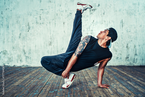 Young man break dancing - 117764069
