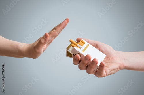 Fotografía Quitting smoking concept. Hand is refusing cigarette offer.