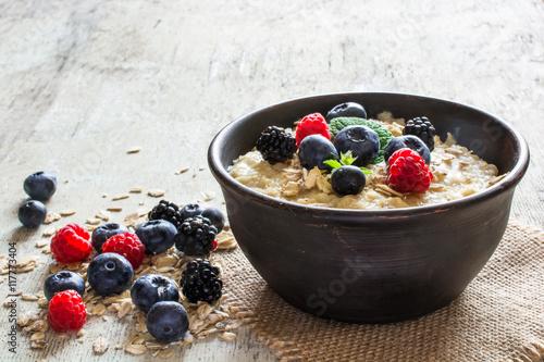 Fototapeta oatmeal porridge in a bowl obraz