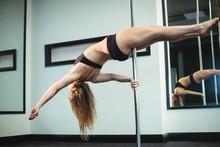 Pole Dancer Practicing Pole Dance