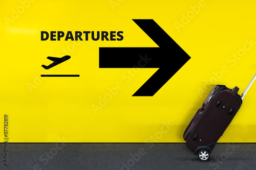 Airport Sign With Departures Airplane Icon on the Yellow Wall Canvas Print