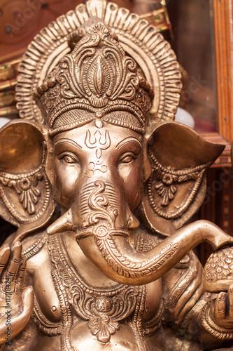 Photo  A brass deity of Ganesh