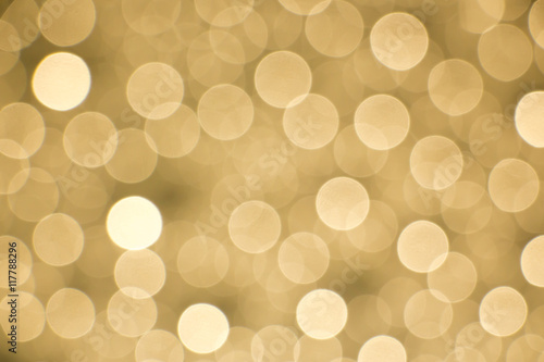 Leinwand Poster Glowing golden bokeh background for designing purposes