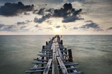 Fototapeta Industrialny Old wood bridge to sea
