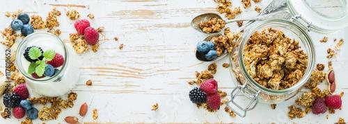 Fototapeta Granola with berries on white wood background obraz