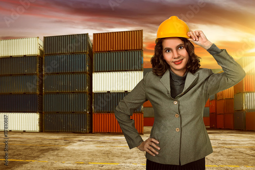 d2d07715951 Asian business woman wearing yellow helmet on harbour - Buy this ...