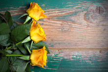 Bouquet Of Orange Roses On A Wooden Background