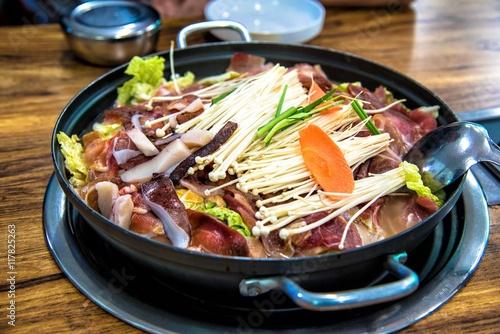 Fotografie, Obraz  Korean-Style Hot Pot with Enoki Mushrooms and Pork
