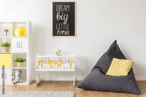 Beanbag chair in baby room Canvas Print