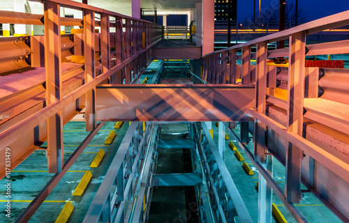 Deurstickers Industrial geb. Abstract modern art industrial architecture, garage interior, modern lighting. Interior design, steel beams, night photography. Urban geometry.
